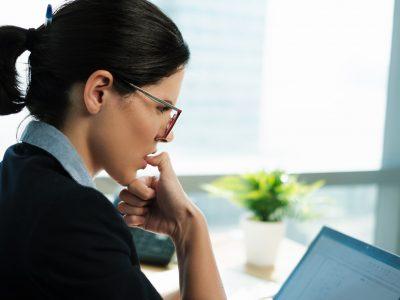 Beautiful Business Woman Bitting Her fingernails at work office